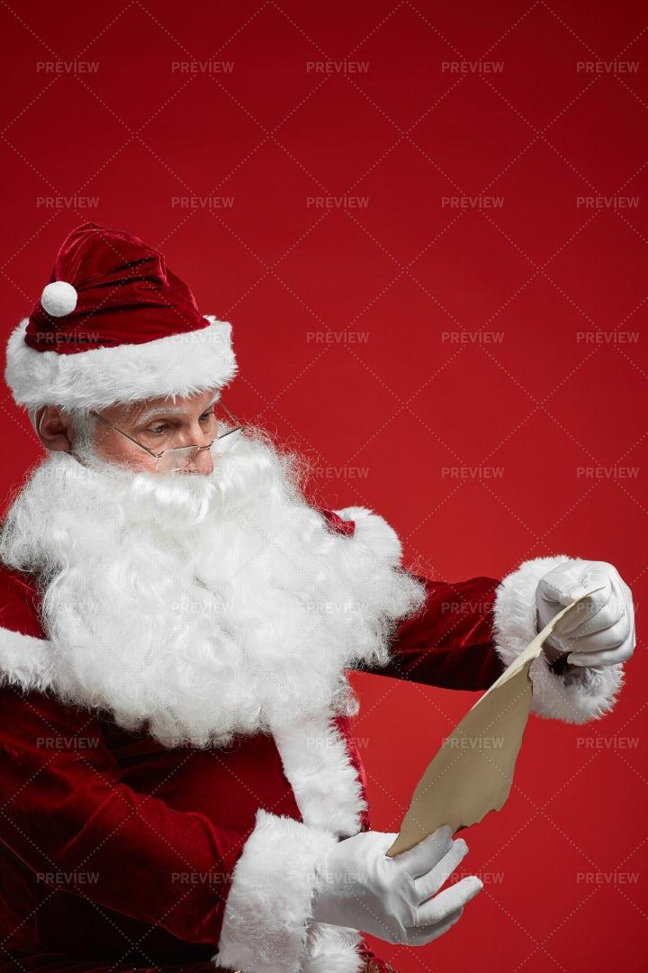 Santa Reading A Letter: Stock Photos