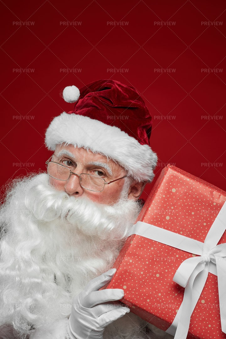Santa Holding Christmas Present: Stock Photos