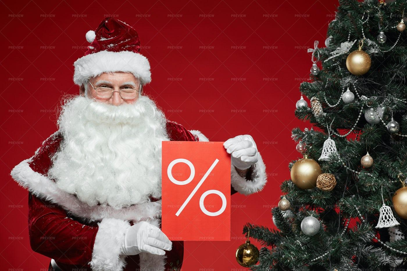 Santa Claus Making Sale: Stock Photos