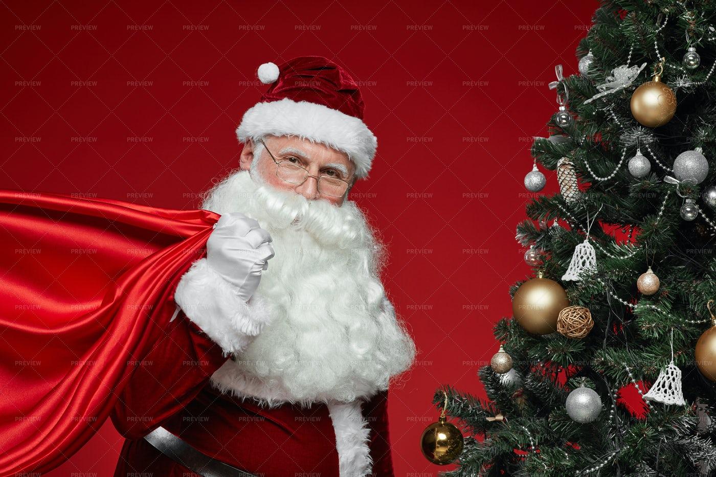 Santa Claus Bringing Presents: Stock Photos
