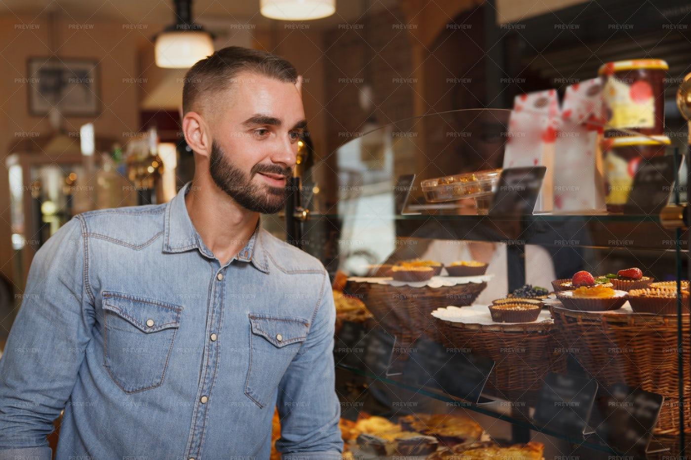 Man Buying Pastry: Stock Photos