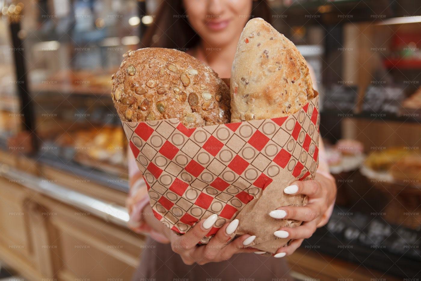 Baker Showing Fresh Bread: Stock Photos