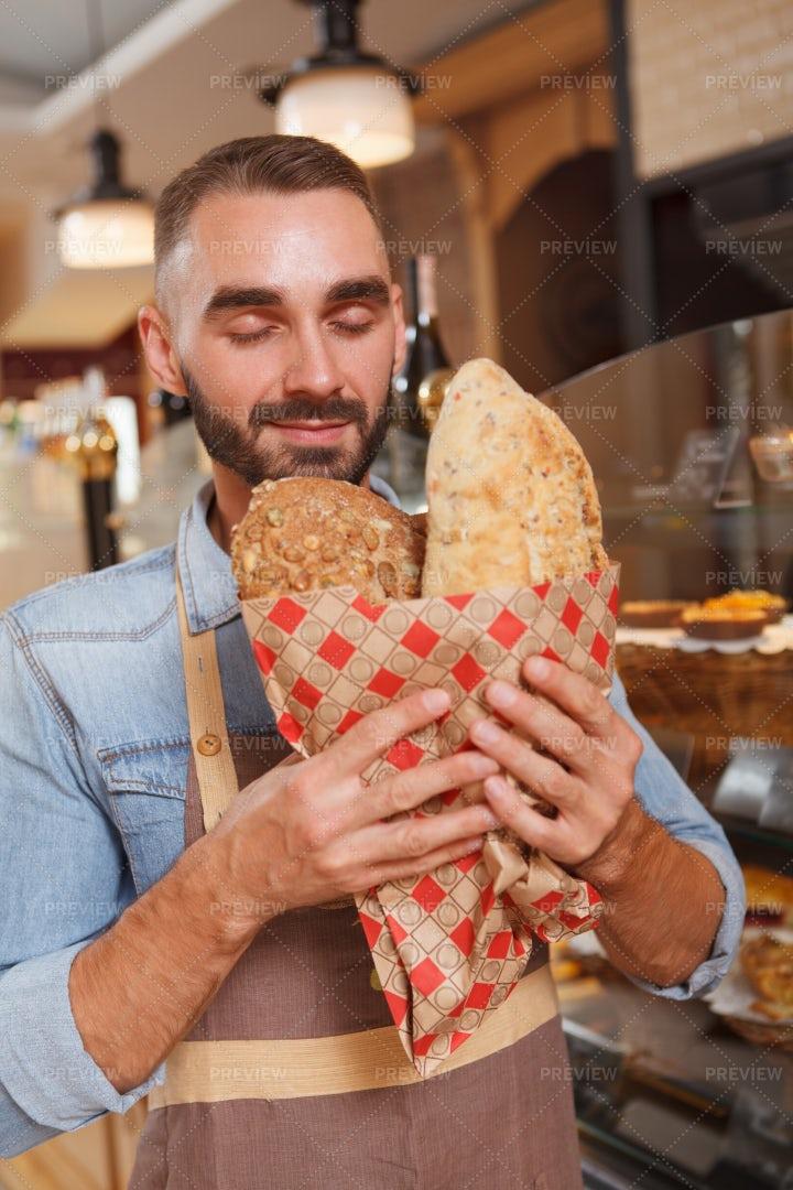 Smelling Bread: Stock Photos