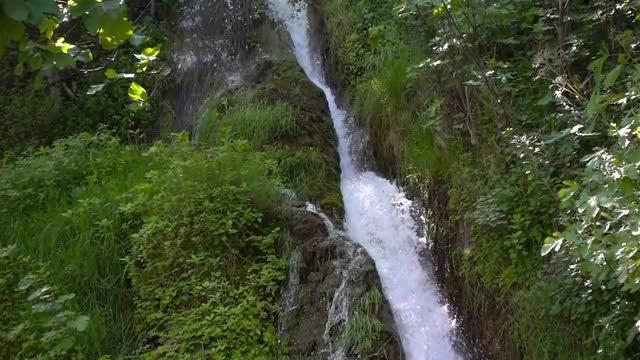 POV Of Narrow Waterfall: Stock Video
