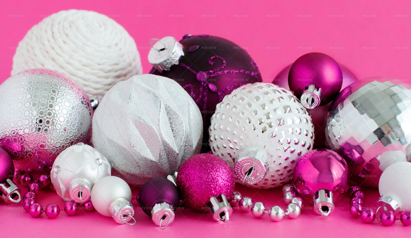 Christmas Baubles On A Purple Background: Stock Photos