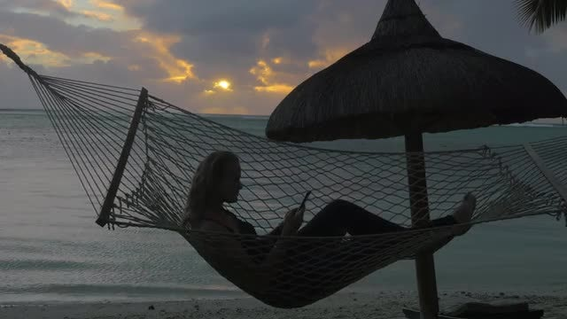 Woman On Beach Hammock: Stock Video