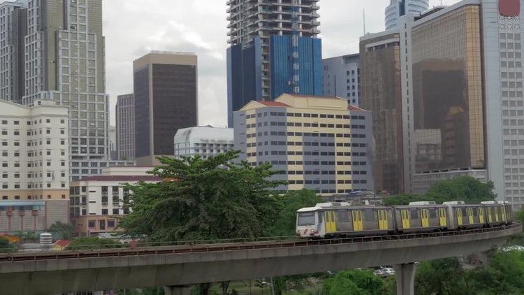 Train Moving Through Cityscape : Stock Video