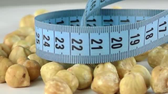 Close-Up Shot Of Hazelnuts: Stock Video