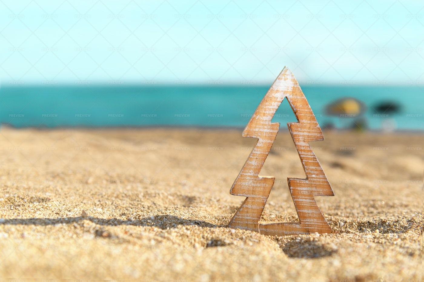 Wood Christmas Decoration On The Beach: Stock Photos