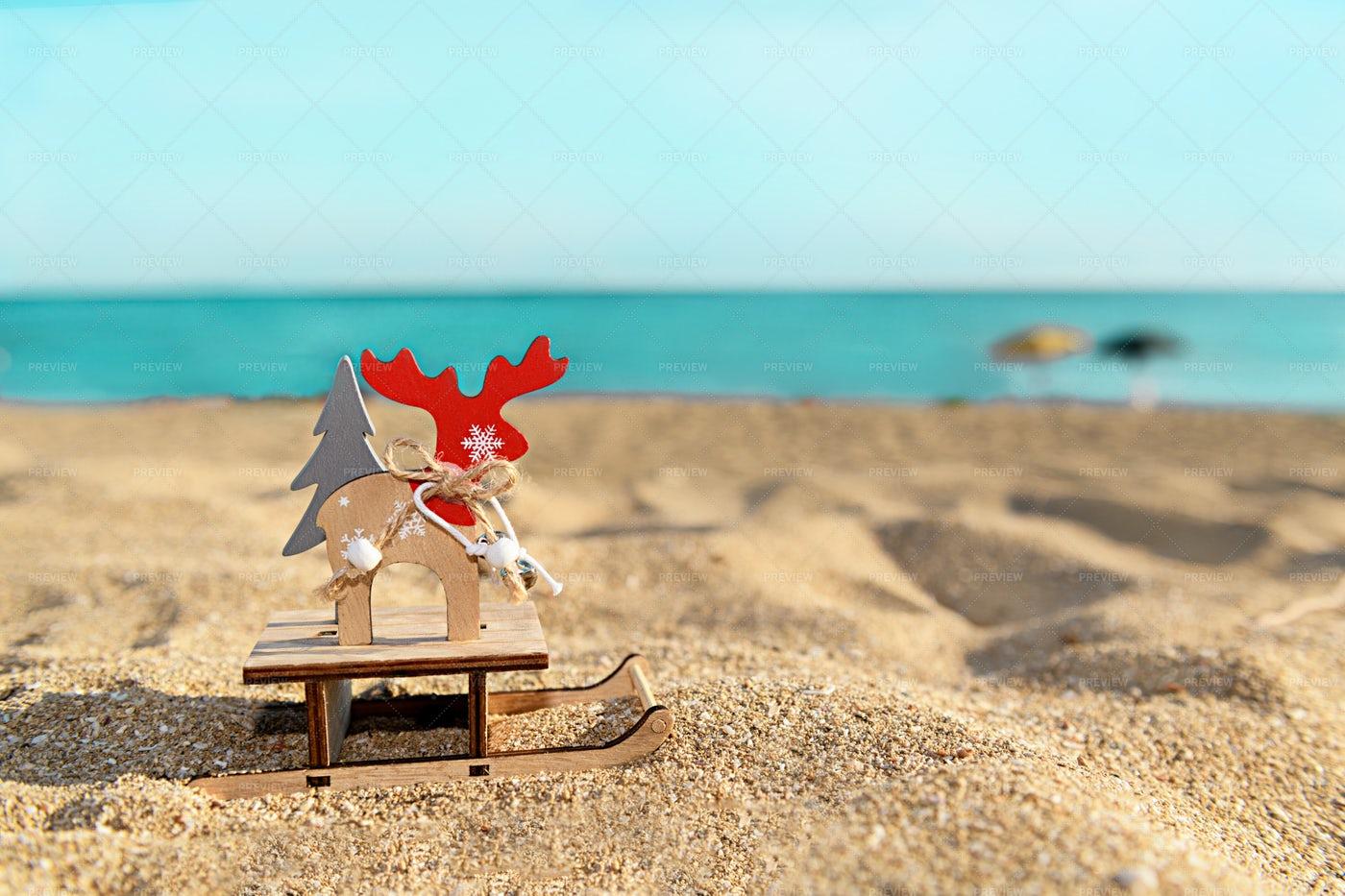 Reindeer Christmas Ornament On Beach: Stock Photos