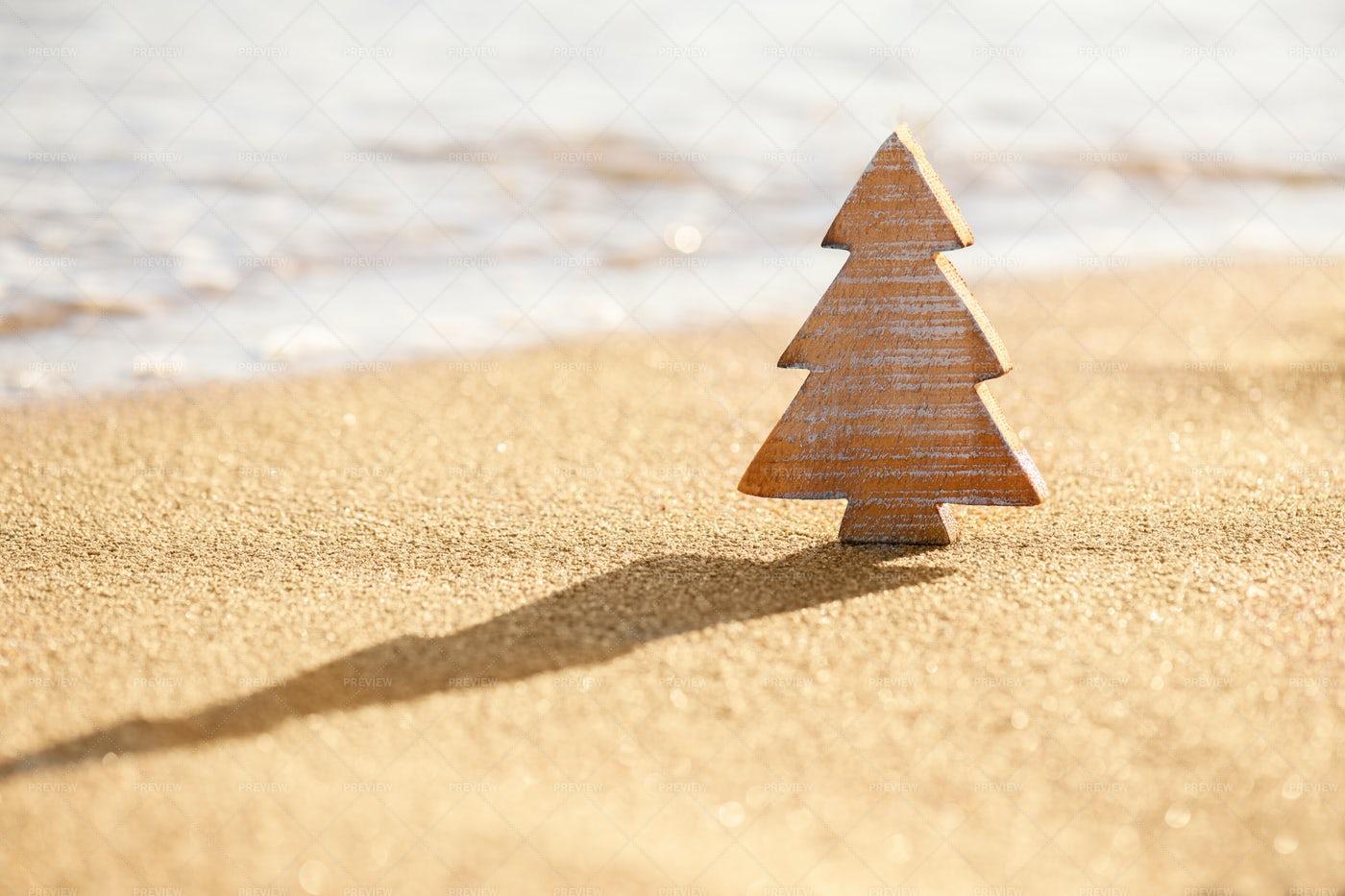 Small Wood Christmas Tree On The Beach: Stock Photos