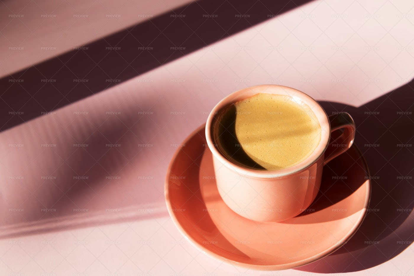 Coral Coffee Cup With Shadows: Stock Photos