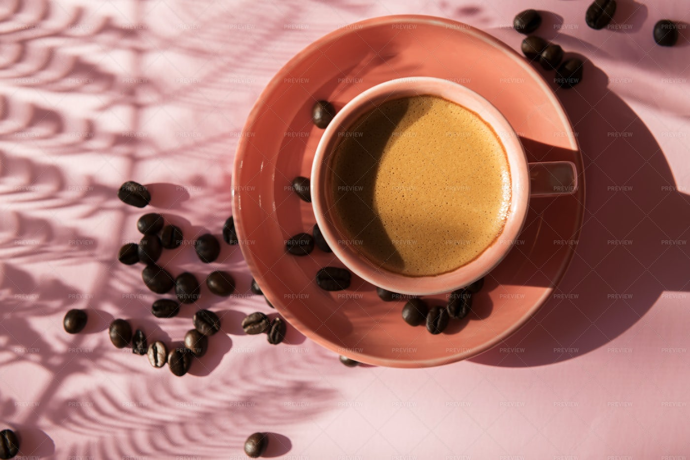 Coral Cup With Coffee Beans: Stock Photos