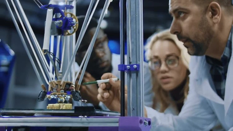 Researchers Watch 3-D Printing: Stock Video