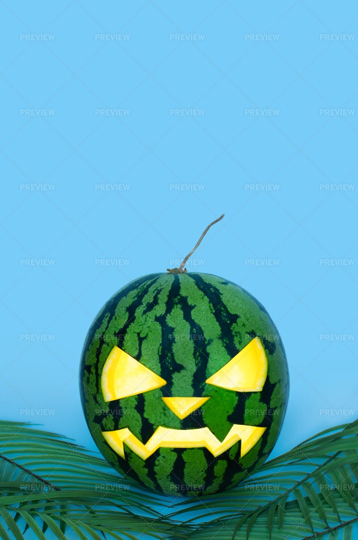 Glowing Carved Halloween Watermelon: Stock Photos