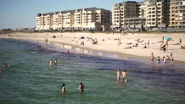 Vacationers On A Popular Beach: Stock Video
