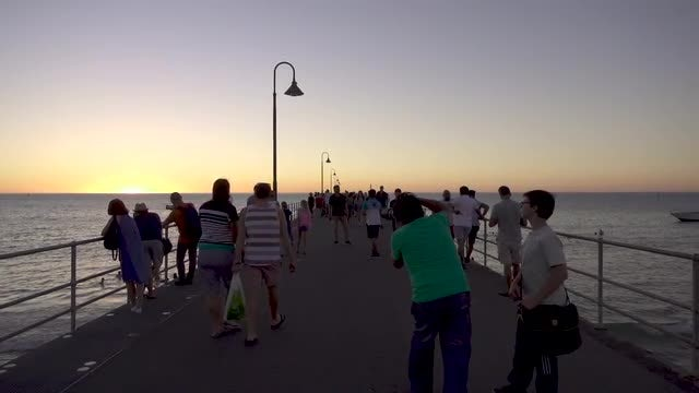 Tourists On Pier At Sunset: Stock Video