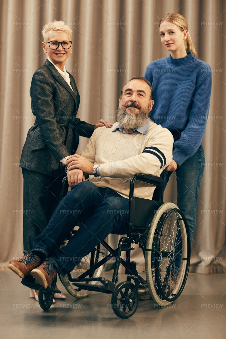 Disabled Man With Family: Stock Photos