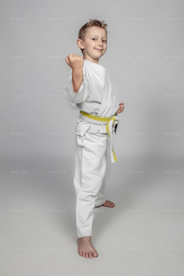 Smiling Child Practicing Martial Arts: Stock Photos