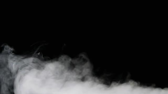 White Smoke On Black Background: Stock Video