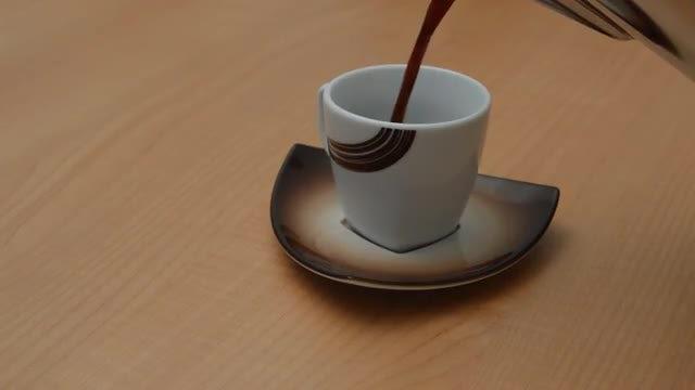 Coffee Poured into Small Cup: Stock Video