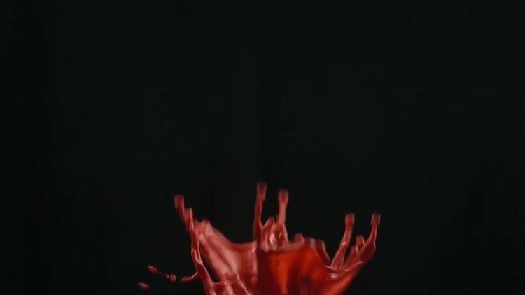 Liquid Orange Paint Splashing: Stock Video