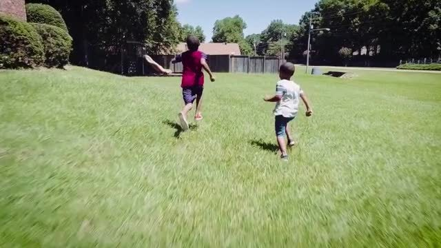 Kids Run Through Grass : Stock Video
