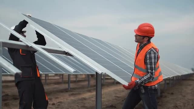 Workers Install A Photovoltaic Panel: Stock Video