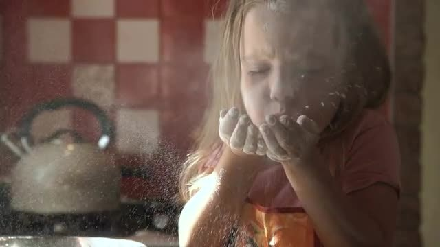 Young Girl Blowing White Flour : Stock Video