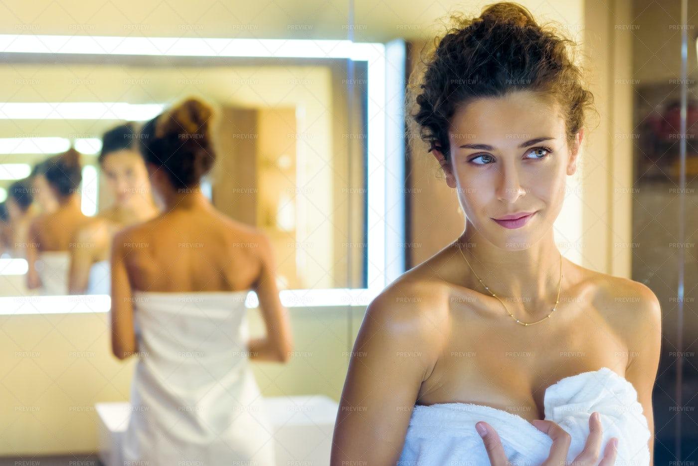 Admiring Her Reflection: Stock Photos