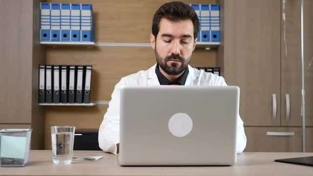 Doctor Typing On His Laptop: Stock Video