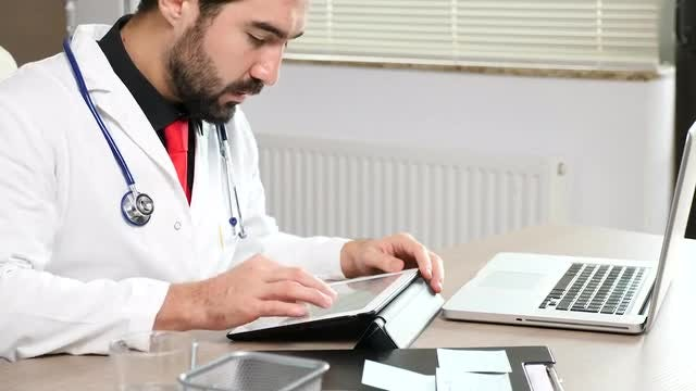 Doctor Scrolling On Tablet PC : Stock Video