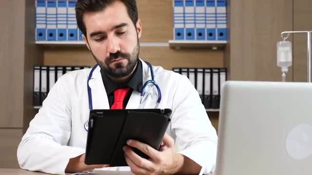 Male Doctor With Tablet PC: Stock Video