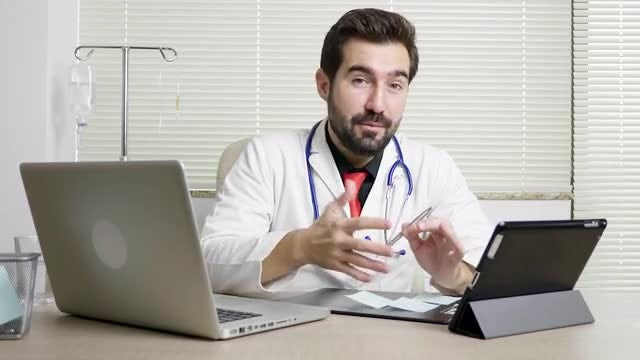 Doctor Giving A Professional Opinion: Stock Video