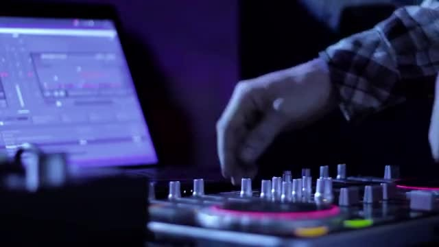 DJ Mixes Tracks In Nightclub: Stock Video