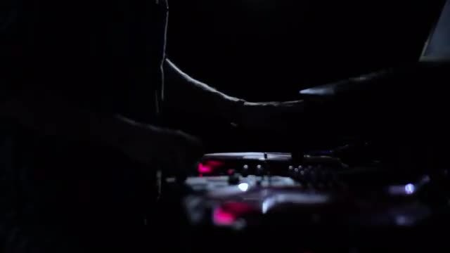 Nightclub DJ Scratching Vinyl Records: Stock Video