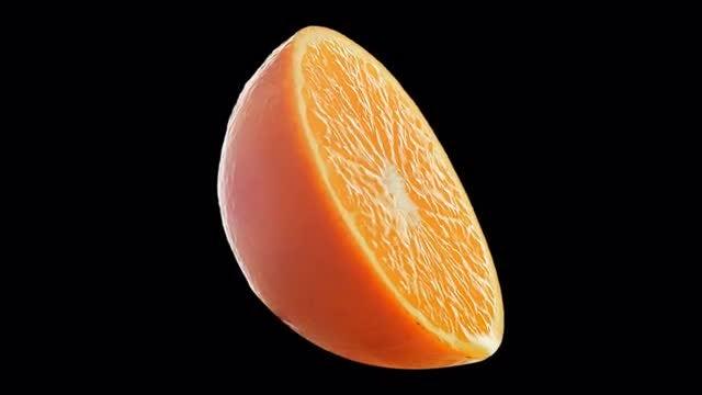 An Orange Slice Rotating: Stock Video