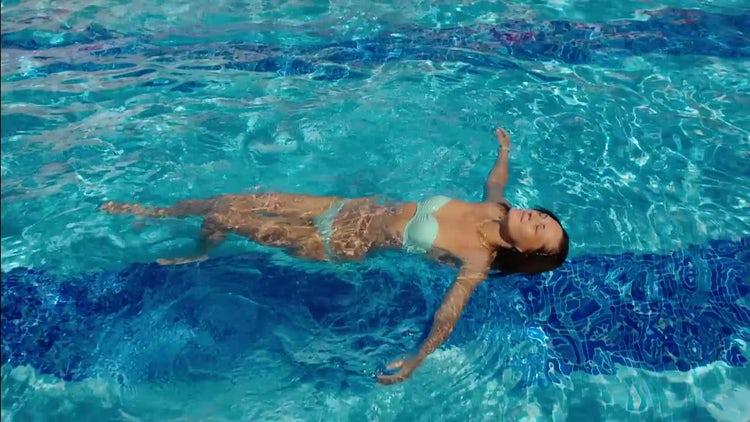 Woman Enjoying Swimming: Stock Video