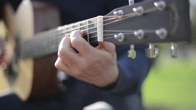 Man Playing Guitar Outdoors: Stock Video