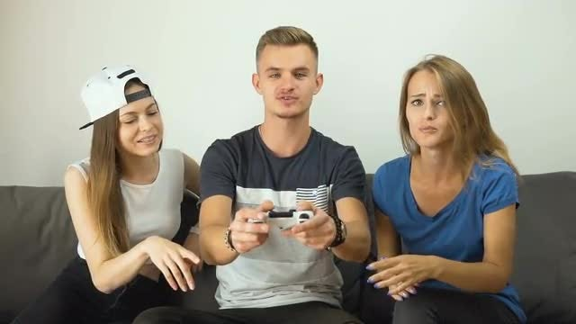 Excited Teens Playing Video Games: Stock Video
