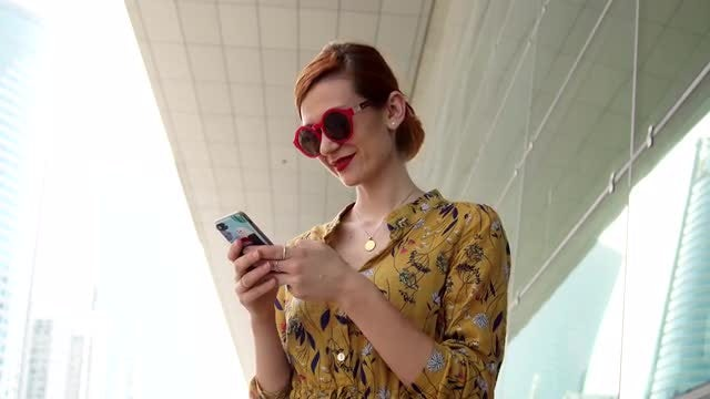 Woman Reading Text On Smartphone : Stock Video