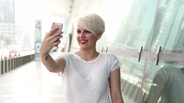 Young Beautiful Woman Taking Selfies : Stock Video