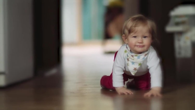 Happy Toddler Crawling On Floor: Stock Video