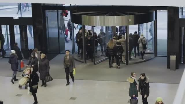 People Entering And Exiting Mall: Stock Video