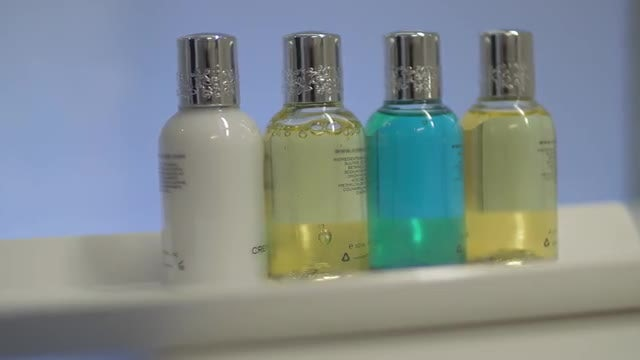 Arranging Shampoo Bottles In Hotel: Stock Video