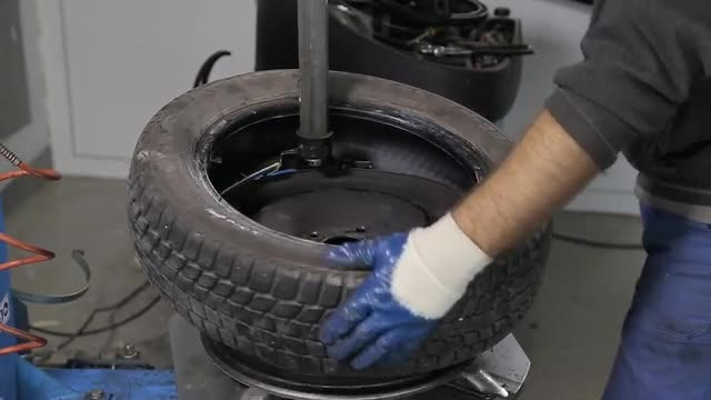 Putting Tire On The Rim: Stock Video