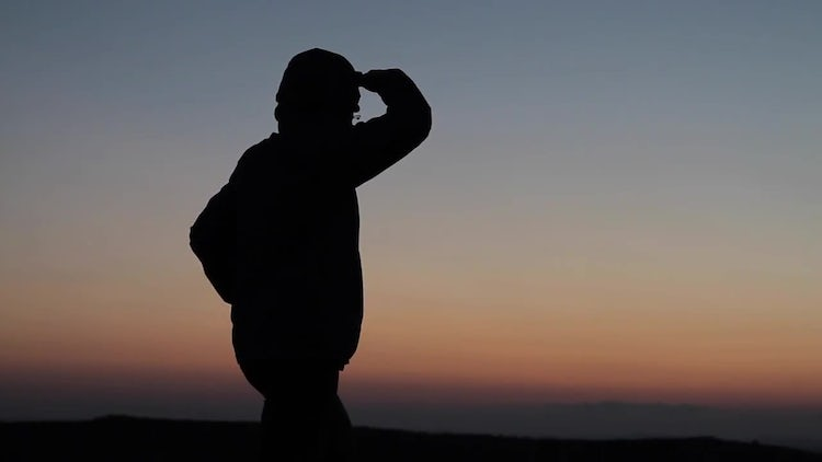 Silhouetted Man Looking Into Distance : Stock Video