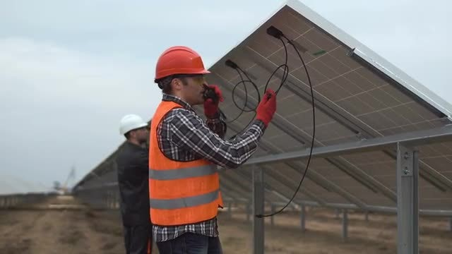 Engineers Connecting Solar Batteries: Stock Video