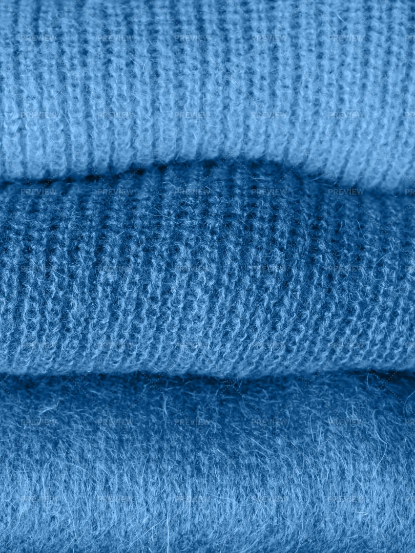Pile Of Blue Sweaters: Stock Photos