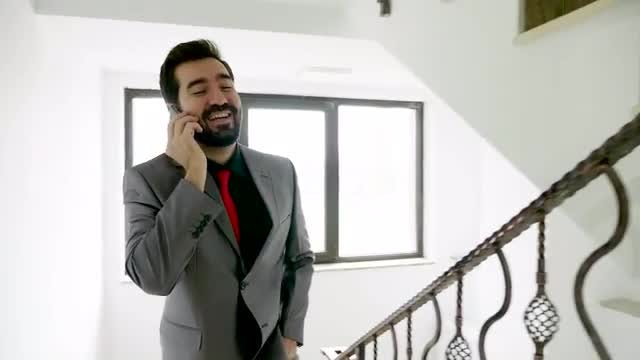 Businessman Takes Call On Stairs: Stock Video